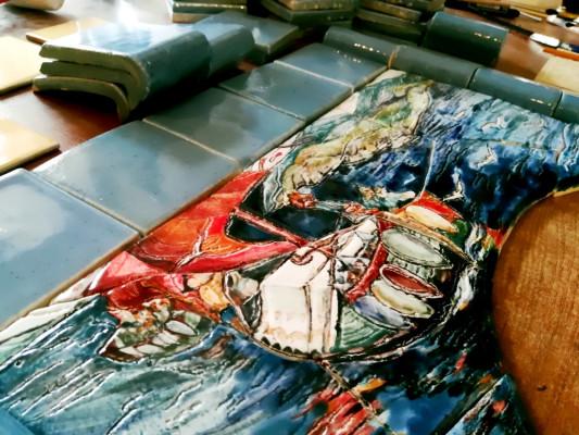 Портал для банной печи с керамичеким панно по мотивам картины Николая Рериха и майоликовыми плитками